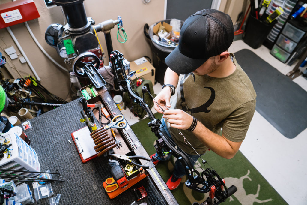Ross Outdoors archery tech tuning a bow for long range bowhunting.