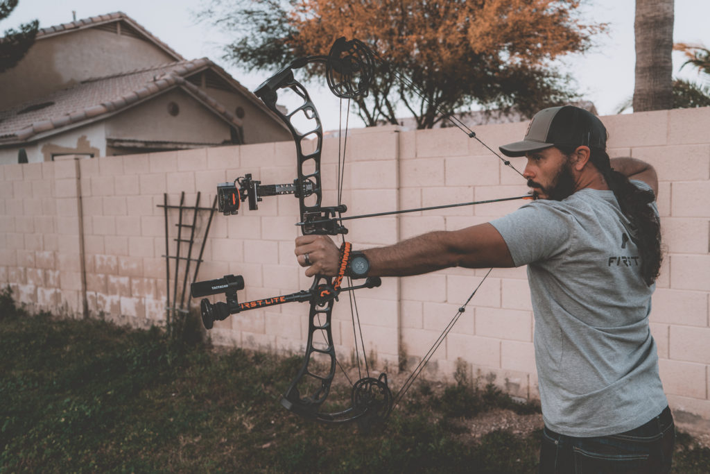 Josh Kirchner practicing bowhunting accuracy in his backyard