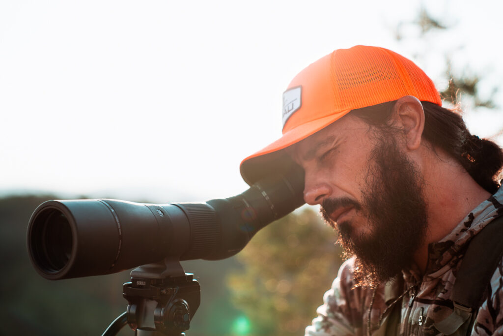 Josh Kirchner from Dialed in Hunter glassing for coues deer in Arizona