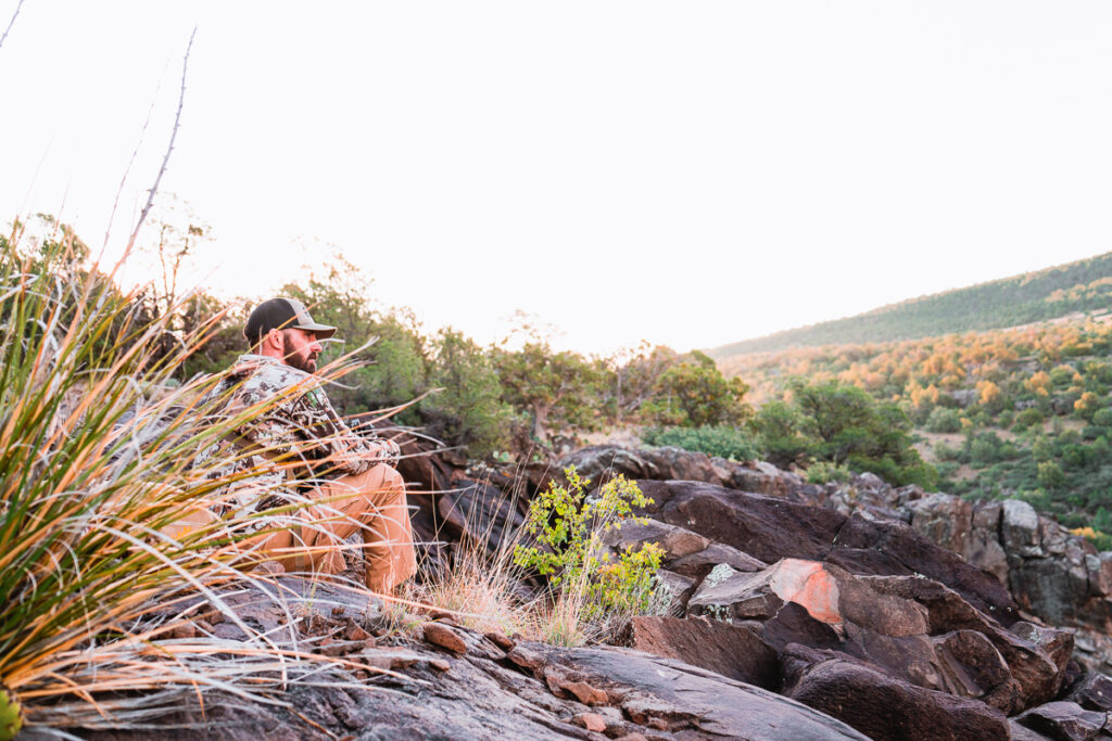 Hunter surveying coues country in Arizona