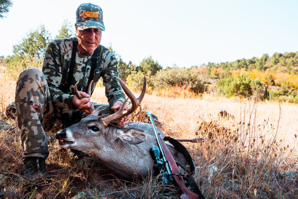 Hunter with coues buck taken on October hunt in Arizona
