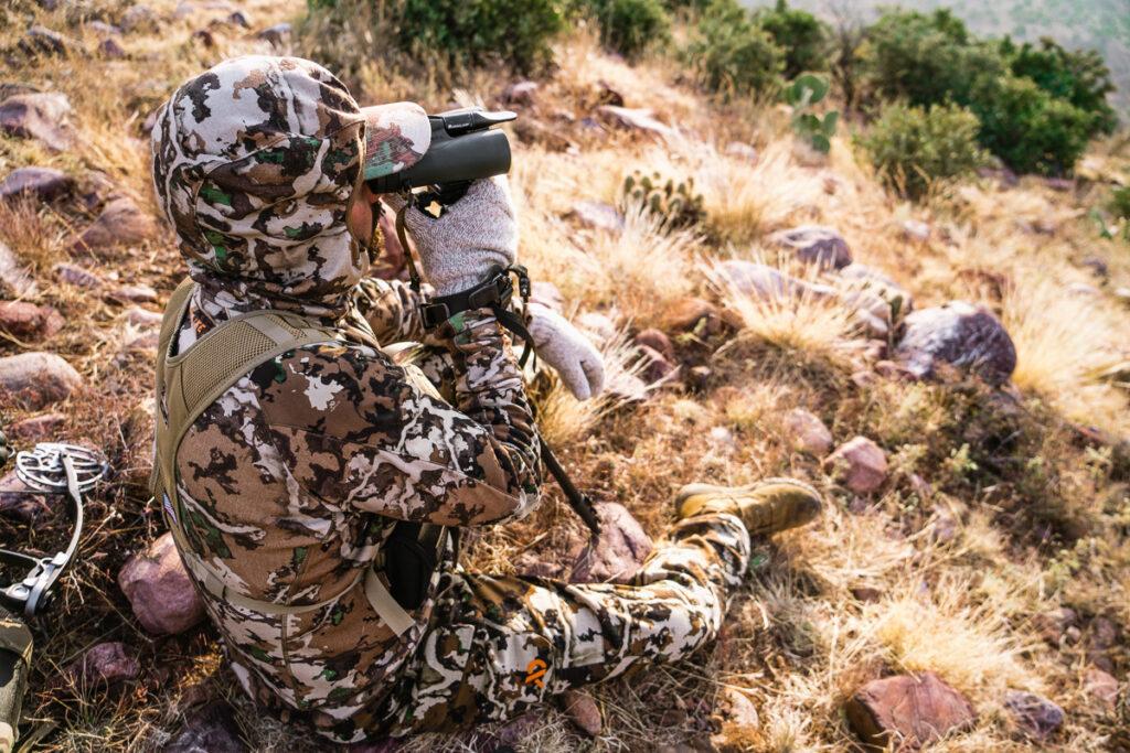 Archery hunter glassing for elk in Arizona