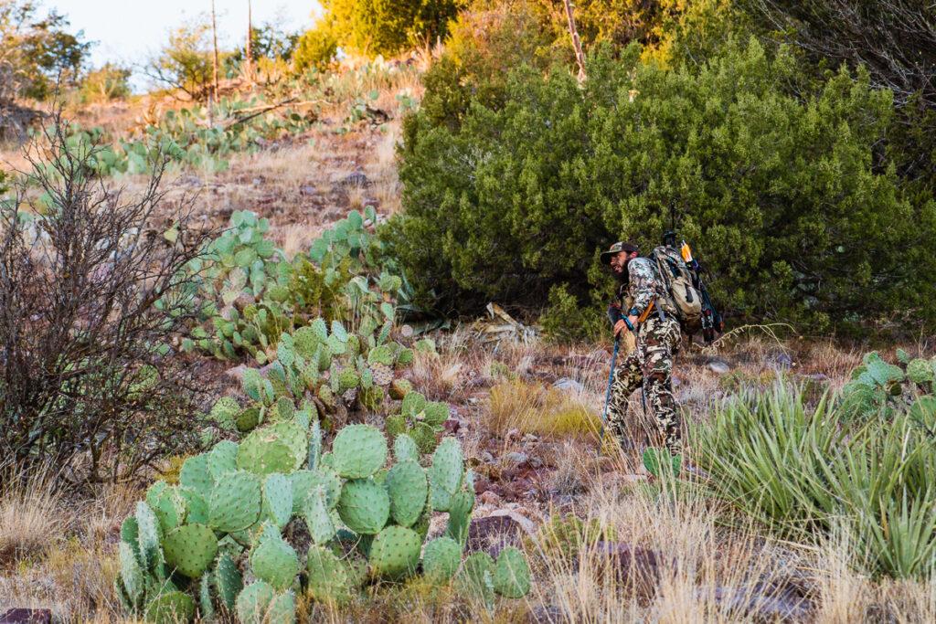 Josh Kirchner from Dialed in Hunter traversing through the Arizona desert on an archery hunt