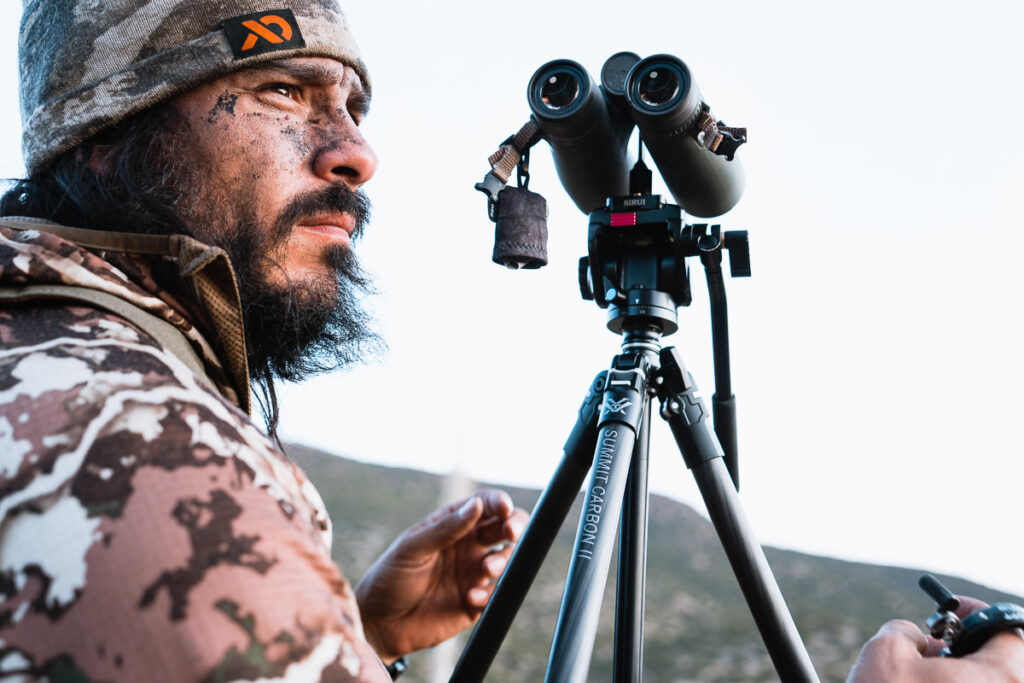 Josh Kirchner of Dialed in Hunter set up to glass for elk from a tripod in Arizona